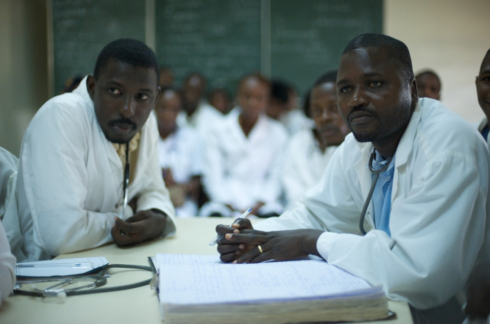 Peadetric doctors at Donka hospital reviewing mealses cases